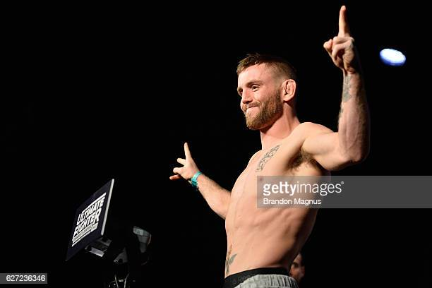 Tim Elliott steps onto the scale during the TUF Finale weigh-in in the Palms Resort & Casino on December 2, 2016 in Las Vegas, Nevada.