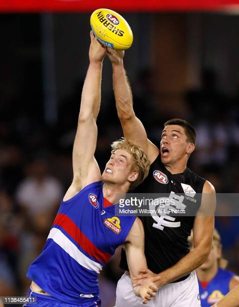 Tim English of the Bulldogs and Matthew Kreuzer of the Blues compete in a ruck contest during the 2019 AFL round 05 match between the Western...