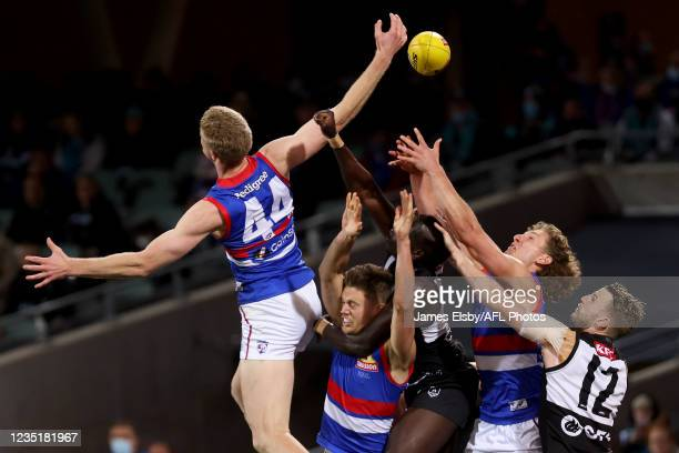 Tim English of the Bulldogs clashes with Aliir Aliir of the Power during the 2021 AFL Second Preliminary Final match between the Port Adelaide Power...
