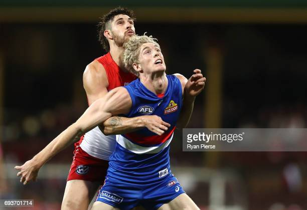 Tim English of the Bulldogs competes in the ruck against Sam Naismith of the Swans during the round 12 AFL match between the Sydney Swans and the...