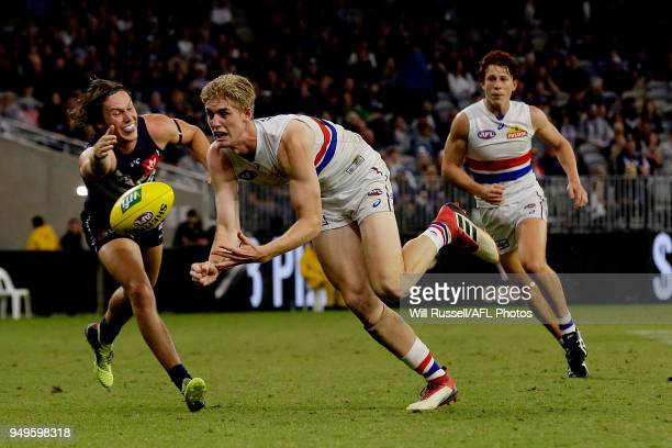 Tim English of the Bulldogs handpasses the ball during the round five AFL match between the Fremantle Dockers and the Western Bulldogs at Optus...