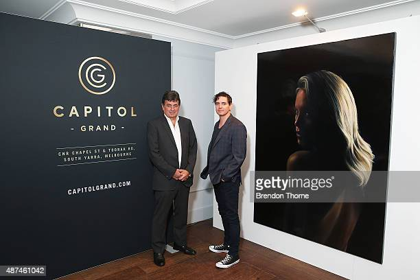 Tim Etchells and Artist, Vincent Fantauzzo pose in front of his portrait unveiling of Charlize Theron on September 10, 2015 in Sydney, Australia.