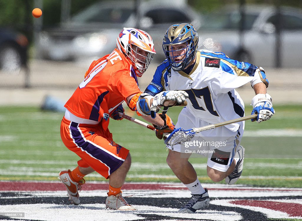 Tim Fallon #77 of the Charlotte Hounds chases after the ball against Matt Dolente #19 of the Hamilton Nationals in a Major League Lacrosse game on May 17, 2013 at Ron Joyce Stadium in Hamilton, Ontario, Canada.