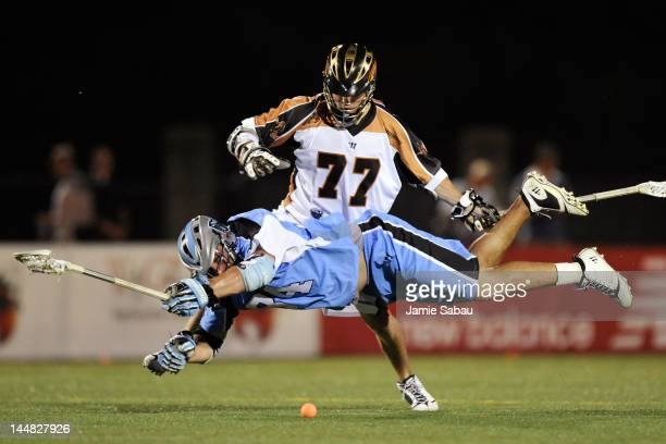 Tim Fallon of the Rochester Rattlers and Anthony Kelly of the Ohio Machine battle for control of the ball off the faceoff on May 19 2012 at Selby...