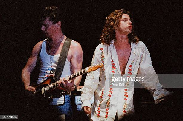 Tim Farriss and Michael Hutchence of INXS perform on stage on the 'Kick' tour at Wembley Arena on June 24th 1988 in London United Kingdom