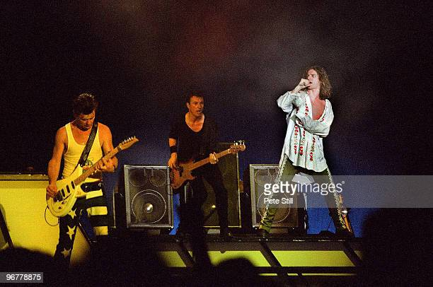 Tim Farriss Garry Beers and Michael Hutchence of INXS perform on stage on the 'Kick' tour at Wembley Arena on June 24th 1988 in London United Kingdom