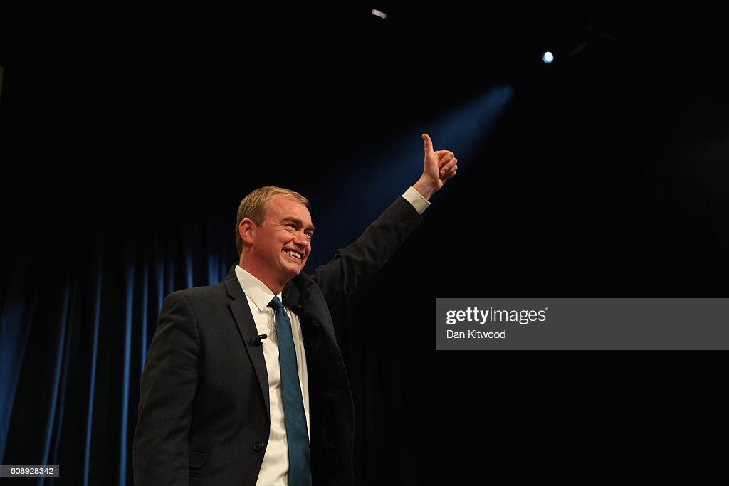 Tim Farron, leader of the Liberal Democrats, gestures to the audience after delivering a speech on the final day of the Liberal Democrats' 2016 Autumn Conference on September 20, 2016 in Brighton, England. Farron is delivering his final speech of the conference to party members today during which he is expected to announce that one of his party's key pledges would be to raise taxes to fund shortfalls in the NHS.