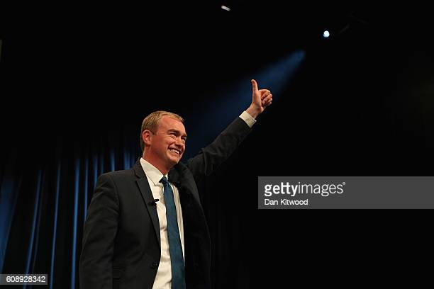 Tim Farron leader of the Liberal Democrats gestures to the audience after delivering a speech on the final day of the Liberal Democrats' 2016 Autumn...