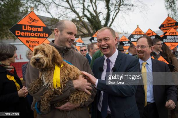 Tim Farron leader of the Liberal Democrats strokes Bonnie a Cockapoo during campaigning for the UK general election at Eastfield regeneration site in...