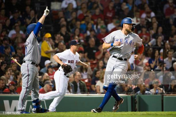 Tim Federowicz celebrates as teammate Hunter Pence of the Texas Rangers scores in the fifth inning against the Boston Red Sox at Fenway Park on June...