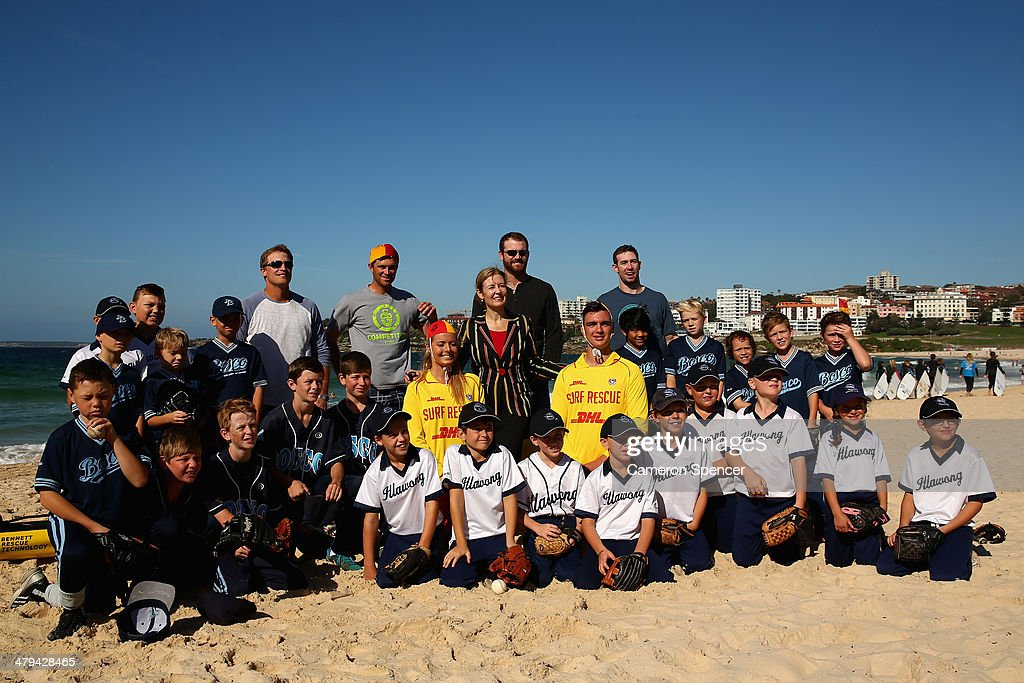 Tim Federowicz, Drew Butera, New South Wales Minister for Sport Gabrielle Upton, Chris Withrow and Mike Baxter of the Los Angeles Dodgers pose with players from Illawong and St John Bosco little league during a Los Angeles Dodgers players visit at Bondi Beach on March 19, 2014 in Sydney, Australia.