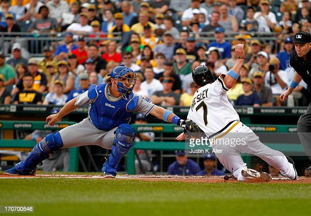 Tim Federowicz of the Los Angeles Dodgers tags out Alex Presley of the Pittsburgh Pirates in the first inning during the game on June 16 2013 at PNC...