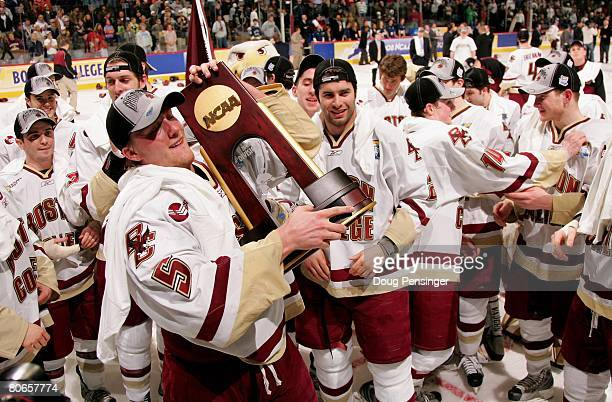Tim Filangieri of the Boston College Golden Eagles hoists the trophy as they celebrate defeating the Notre Dame Fighting Irish 4-1 in the 2008 NCAA...