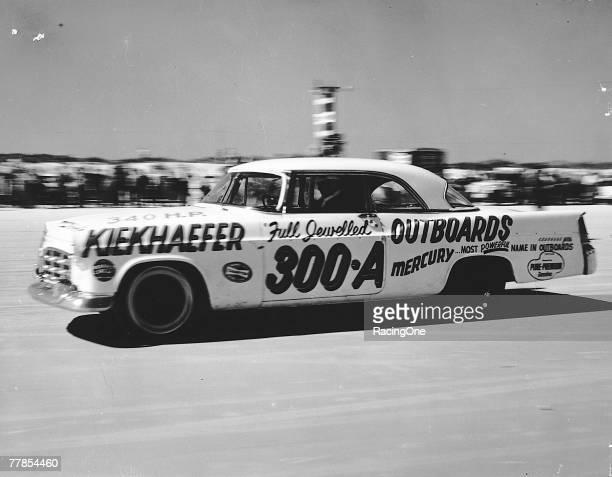 Tim Flock in the Karl Kiekhaefer Chrysler 300 on Daytona Beach in 1956 winner of the event The multiplecar team brought about the first presence in...