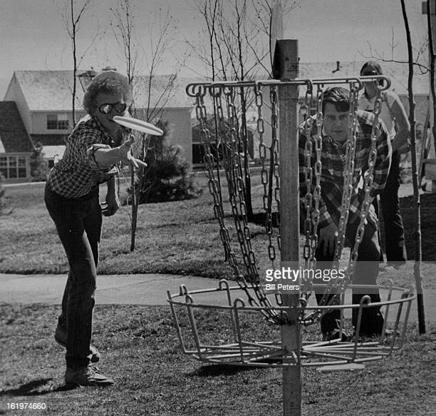 FLIGHT Tim Forbriger putts for a baskettype hole while Veeder Dorn watches from behind chains during Disc Golf Tournament Saturday at KenCaryl Ranch...