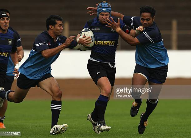 Tim Fraser of Ponsonby is tackled during the Auckland Club Rugby Alan McEvoy Trophy match between Ponsonby and Teachers Eastern at Western Springs...