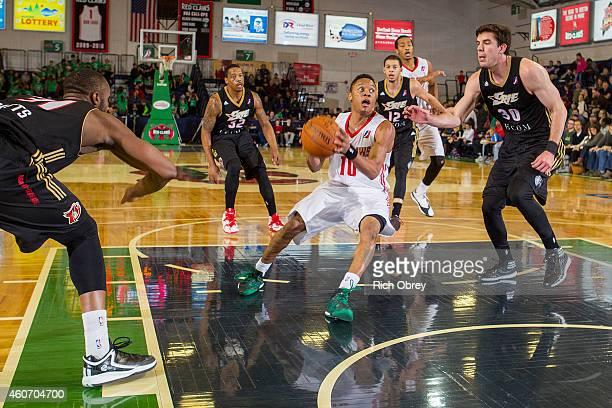Tim Frazier of the Maine Red Claws drives against Daniel Coursey of the Erie BayHawks on December 19 2014 at the Portland Expo in Portland Maine NOTE...