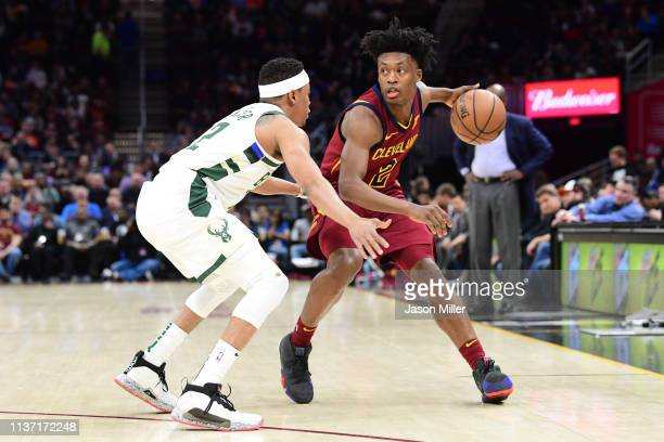 Tim Frazier of the Milwaukee Bucks guards Collin Sexton of the Cleveland Cavaliers during the first half at Quicken Loans Arena on March 20 2019 in...