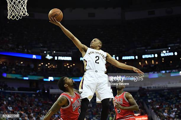 Tim Frazier of the New Orleans Pelicans drives to the basket against Aaron Brooks of the Chicago Bulls during the first half of a game at the...