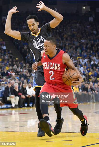 Tim Frazier of the New Orleans Pelicans drives towards the basket on Shaun Livingston of the Golden State Warriors in the first quarter of their NBA...