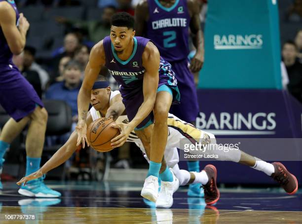 Tim Frazier of the New Orleans Pelicans goes after a loose ball against Jeremy Lamb of the Charlotte Hornets during their game at Spectrum Center on...