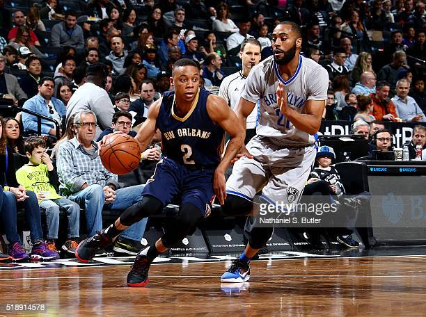 Tim Frazier of the New Orleans Pelicans handles the ball during the game against Wayne Ellington of the Brooklyn Nets on April 3 2016 at Barclays...