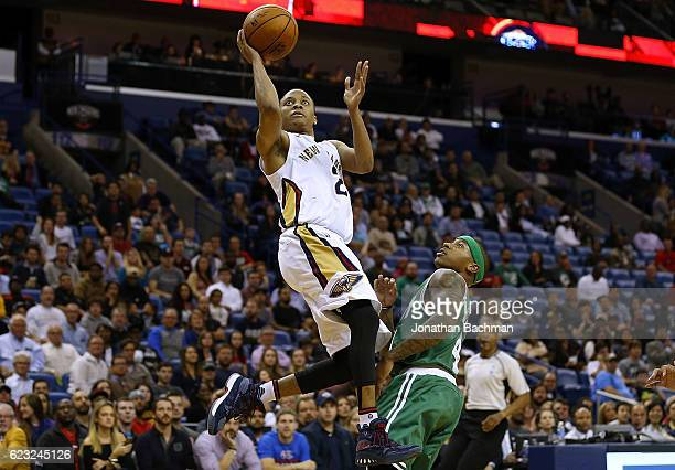 Tim Frazier of the New Orleans Pelicans shoots over Isaiah Thomas of the Boston Celtics during the second half of a game at the Smoothie King Center...