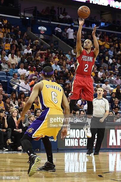 f76befd77ba1ba Tim Frazier of the New Orleans Pelicans shoots over Jordan Clarkson of the Los  Angeles Lakers