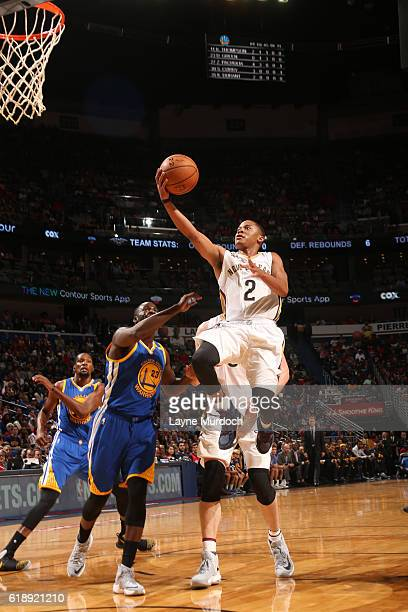 Tim Frazier of the New Orleans Pelicans shoots the ball Golden State Warriors during the game on October 26 2016 at the Smoothie King Center in New...
