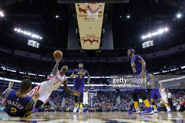 Tim Frazier of the New Orleans Pelicans takes a charge against Patrick Beverley of the Houston Rockets during the second half of a game at the...