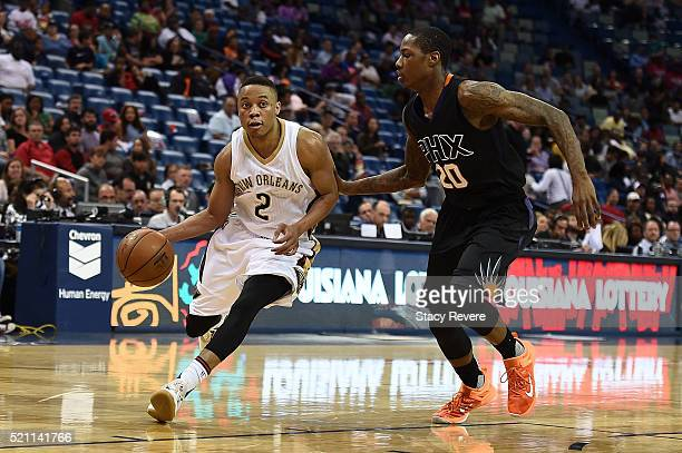 Tim Frazier of the New Orleans Pelicans works against Archie Goodwin of the Phoenix Suns during a game at Smoothie King Center on April 9 2016 in New...