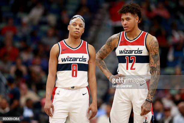 Tim Frazier of the Washington Wizards and Kelly Oubre Jr #12 of the Washington Wizards stand on the court during the second half of a NBA game...