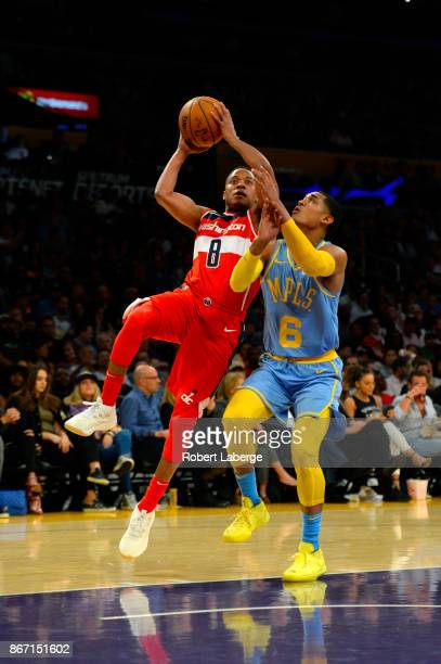 cc1f18cc04bc65 Tim Frazier of the Washington Wizards attempts a shot against Jordan  Clarkson of the Los Angeles