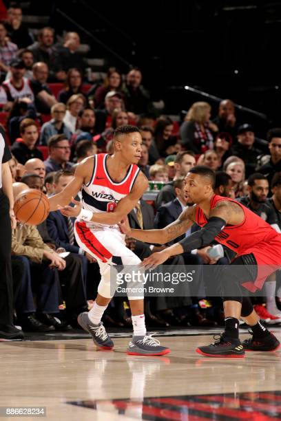 Tim Frazier of the Washington Wizards handles the ball against Damian Lillard of the Portland Trail Blazers on December 5 2017 at the Moda Center in...