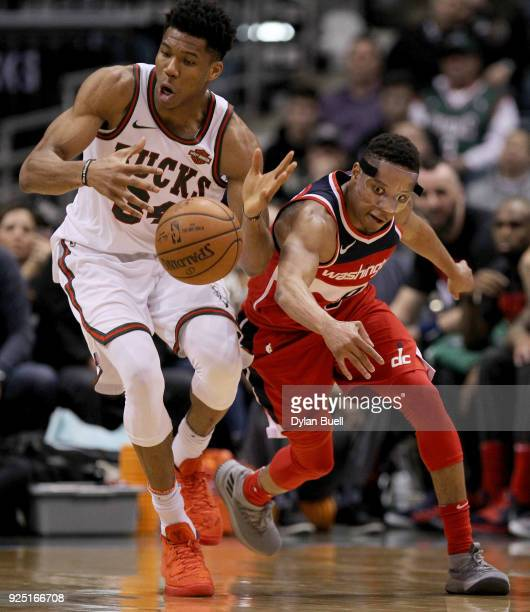 Tim Frazier of the Washington Wizards knocks the ball away from Giannis Antetokounmpo of the Milwaukee Bucks in the third quarter at the Bradley...