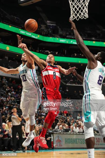 Tim Frazier of the Washington Wizards Michael CarterWilliams of the Charlotte Hornets and Johnny O'Bryant III of the Charlotte Hornets compete for...