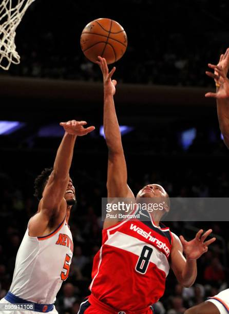 Tim Frazier of the Washington Wizards puts up a shot in front of Courtney Lee of the New York Knicks in a preseason NBA basketball game on October 13...