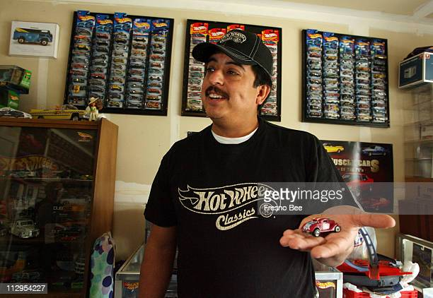 Tim Garcia holds up the Hot Wheels car his future wife gave him when he was 14 Garcia of Fresno California has been collecting Hot Wheels since he...