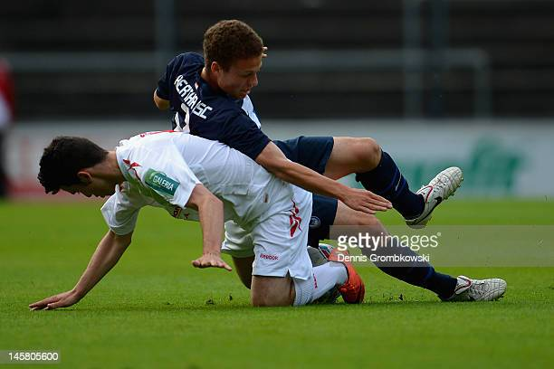 Tim Gerhards of Cologne and Ben Rohloff of Berlin battle for the ball during the B Juniors Bundesliga semi final match between 1 FC Koeln and Hertha...