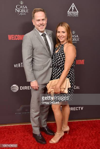 Tim Gibson and wife Lisa arrive at the Welcome Home Premiere at The London West Hollywood on November 4 2018 in West Hollywood California