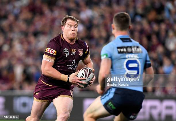 Tim Glasby of Queensland takes on the defence during game three of the State of Origin series between the Queensland Maroons and the New South Wales...