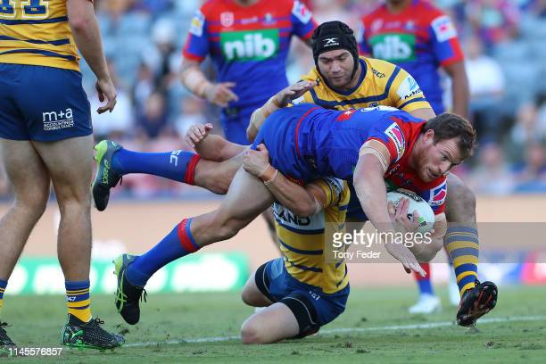 Tim Glasby of the Newcastle Knights is tackled during the round 7 NRL match between the Newcastle Knights and Parramatta Eels at McDonald Jones...