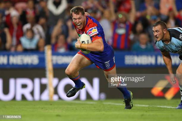 Tim Glasby of the Newcastle Knights scores a try during round one NRL match between the Newcastle Knights and the CronullaSutherland Sharks at...