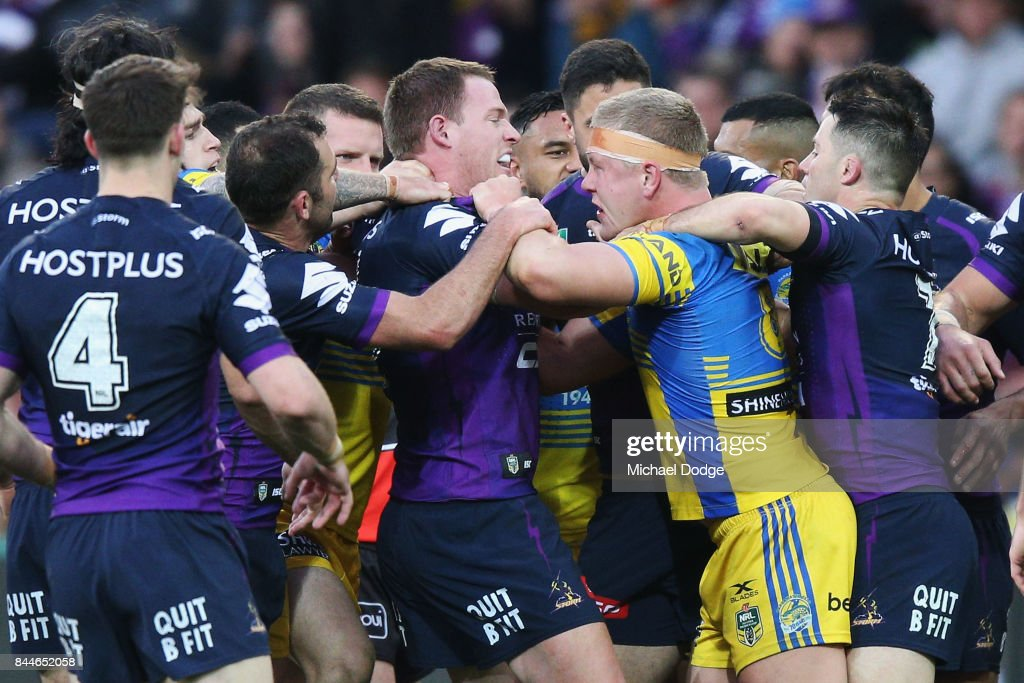 Tim Glasby of the Storm (L) and Daniel Alvaro of the Eels wrestle during the NRL Qualifying Final match between the Melbourne Storm and the Parramatta Eels at AAMI Park on September 9, 2017 in Melbourne, Australia.