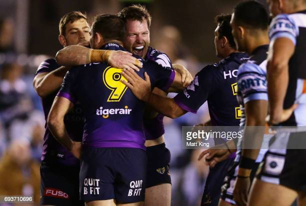 Tim Glasby of the Storm celebrates with team mates after scoring a try during the round 14 NRL match between the Cronulla Sharks and the Melbourne...