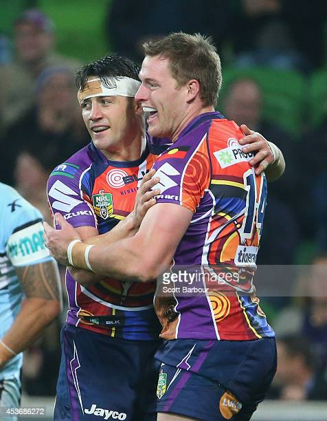 Tim Glasby of the Storm is congratulated by Cooper Cronk after scoring a try during the round 23 NRL match between the Melbourne Storm and the...