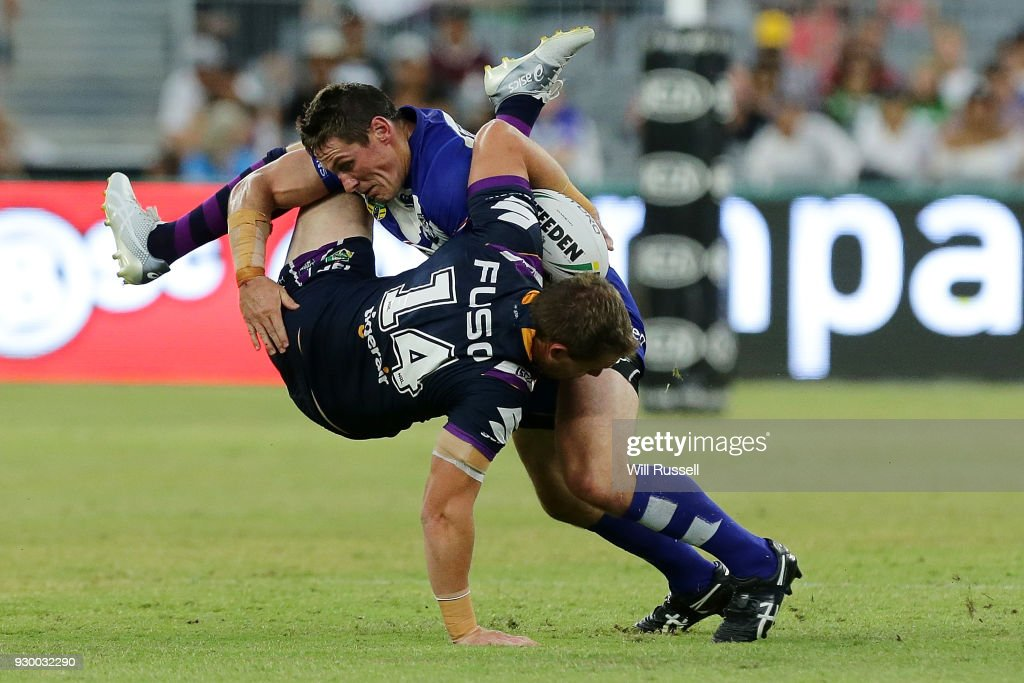 Tim Glasby of the Storm is tackled by Josh Jackson of the Bulldogs during the round one NRL match between the Canterbury Bulldogs and the Melbourne Storm at Optus Stadium on March 10, 2018 in Perth, Australia.