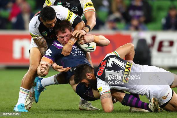 Tim Glasby of the Storm is tackled by the Panthers defence during the round 25 NRL match between the Melbourne Storm and the Penrith Panthers at AAMI...