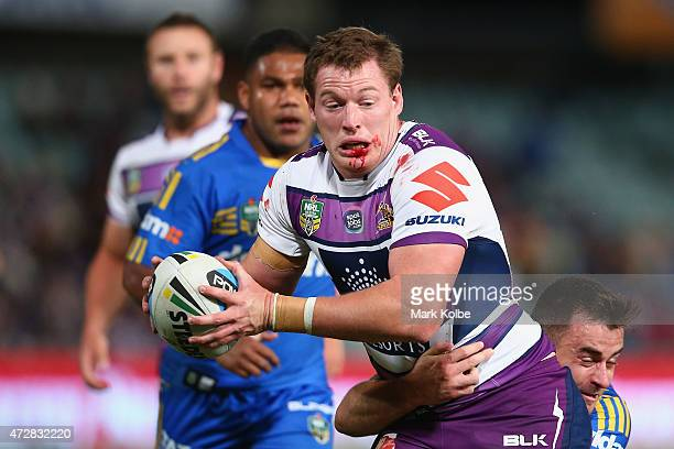 Tim Glasby of the Storm is tackled during the round nine NRL match between the Parramatta Eels and the Melbourne Storm at Pirtek Stadium on May 10...
