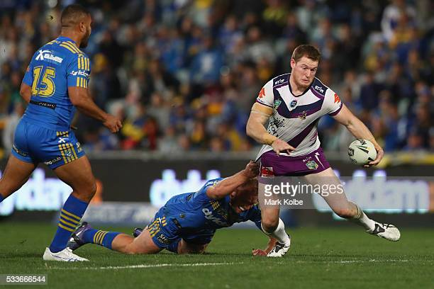 Tim Glasby of the Storm makes break during the round 11 NRL match between the Parramatta Eels and the Melbourne Storm at Pirtek Stadium on May 23...
